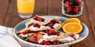 Orange Crepes with Whipped Cream and Berries